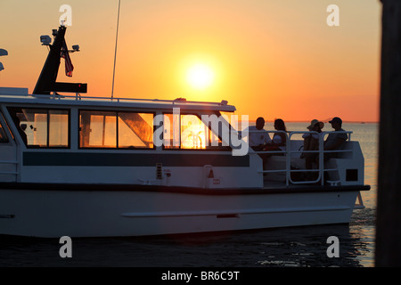 Water taxi at sunset on the Great South Bay near Fair Harbor, Fire Island, NY, USA - Stock Image