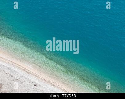 Calm blue sea and beach Nugal in Croatia aerial view - Stock Image
