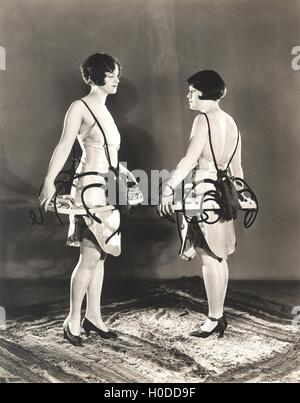 Cigarette girls in lobster bibs making eye contact - Stock Image