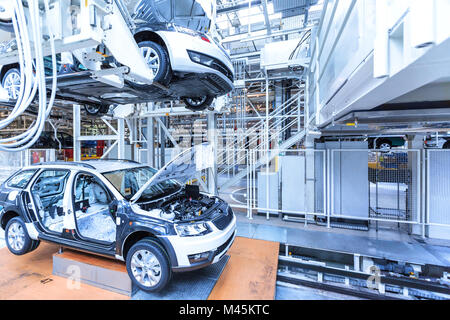 Assembling cars on conveyor line - Stock Image