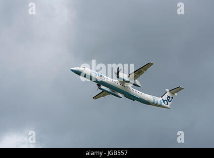 Flybe Dash 8-402 flight leaving Inverness Scotland for Manchester England UK. - Stock Image