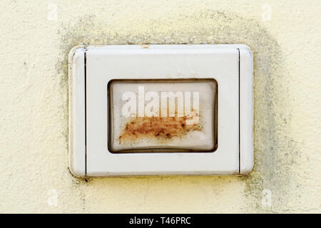 An old door bell on the wall .close up - Stock Image