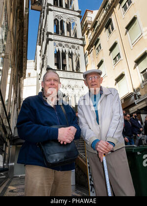 Portugal, Lisbon, elderly and disabled tourists at, Santa Justa Lift, cast iron structure with elevator to Largo do Carmo - Stock Image