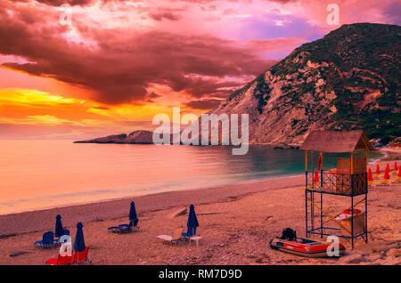 Sunset over Petani beach, Kefalonia island, Greece. View of Petani bay and beautiful beach, Kefalonia island, Greece. - Stock Image