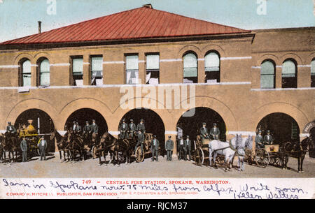 Central Fire Station, Spokane, Washington State, USA, with fire crew and horse-drawn engines. - Stock Image