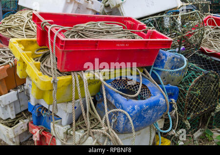 A selection of colourful fishing gear on the harbourside at Brancaster Staithe, North Norfolk, UK - Stock Image
