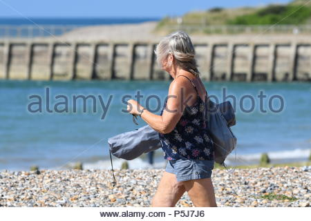 Littlehampton, UK. Wednesday 27th June 2018. A lady on the beach on another very warm and sunny morning in Littlehampton, on the South Coast. Credit: Geoff Smith / Alamy Live News. - Stock Image