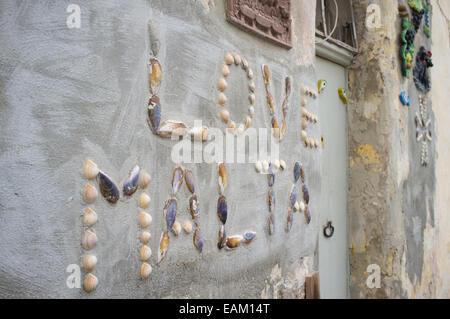 A seashell mosaic set in concrete on the coast of Malta - Stock Image