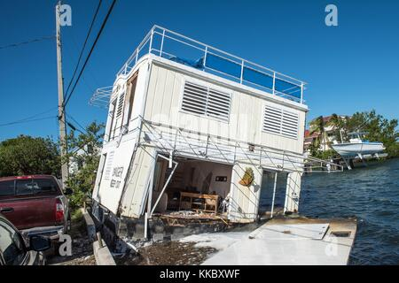 A damaged houseboat sits in the water in the aftermath of Hurricane Irma November 17, 2017 in Key West, Florida. - Stock Image