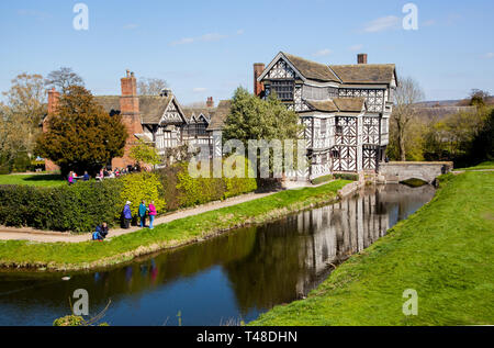 Little Moreton Hall, moated black and white half timbered Tudor manor house near Congleton in Cheshire, owned by the national trust - Stock Image