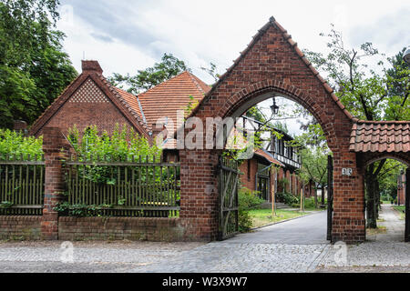Holy Family Church, Berlin-Lichterfelde, arched entrance & Red Brick  building designed by Architect Christoph Hehl and built 1902-4, Catholic Parish - Stock Image