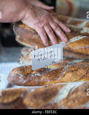 Cropped Hands Picking Breadsticks At Shop - Stock Image