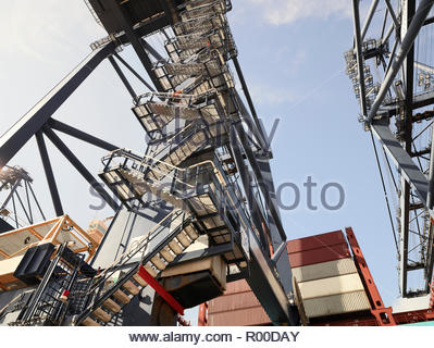 Low angle view of crane steps at Port of Felixstowe, England - Stock Image
