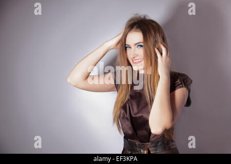 Studio portrait of fun young girl laughing - Stock Image
