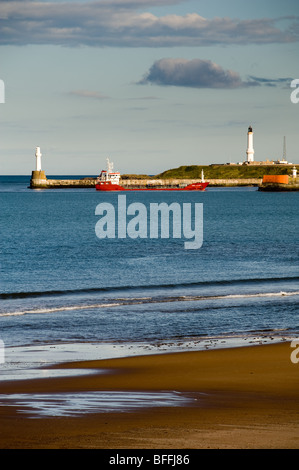 photograph of gas supply tanker vessel entering Aberdeen harbour Scotland - Stock Image