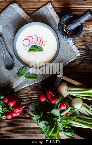 Nutritious creamy radish soup in a ceramic bowl - Stock Image
