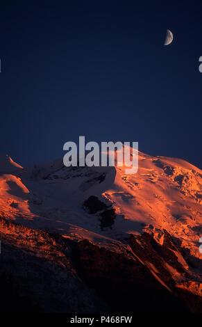Moonrise and sunset on Mont Blanc - Stock Image
