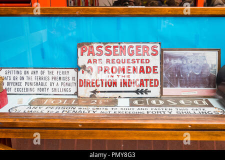 Liverpool Birkenhead Mersey Ferries Woodside Terminal Merseyside River Mersey display old signs toll 2 1/2d no spitting fine 40 shillings photo - Stock Image