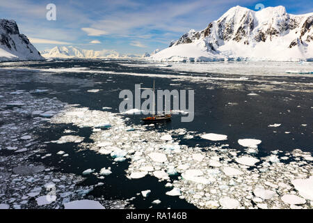 Sailing through the icy waters of Lemaire Channel, Antarctica - Stock Image