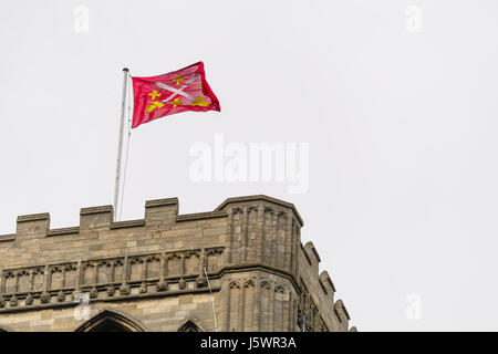 Flag above the eastern end of the medieval christian cathedral at Peterborough England. - Stock Image