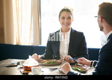 Conversation by lunch - Stock Image