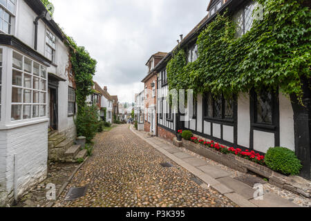 The Mermaid Inn in Mermaid Street showing typically steep slope and cobbled surface, Rye, East Sussex, England, UK - Stock Image