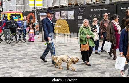 Brighton UK 4th May 2019 - Fashionable visitors enjoy the sunny but cool weather in Brighton today with unsettled conditions forecast for the UK over the next few days. Credit: Simon Dack / Alamy Live News - Stock Image