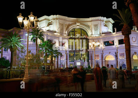 Las Vegas, The Forum Shops at Caesar's palace, at night with blurred people. - Stock Image