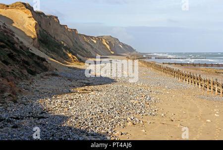 A view along the beach towards Beeston Bump on the North Norfolk coast at West Runton, Norfolk, England, United Kingdom, Europe. - Stock Image