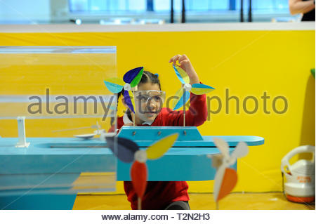 Edinburgh, UK. 3rd April, 2019.  Edinburgh, UK. 3rd April, 2019.  Elia from Royal Mile Primary School try out the wind turbine exhibits at ÒEnergy Makers Ò a new workshop at the City Art Centre (CAC) presented by the FestivalÕs headline sponsors, EDF Energy. Credit: Roger Gaisford/Alamy Live News - Stock Image