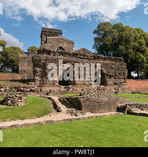 Ruined walls of Roman Baths with St. Nicholas Church behind, Jewry Wall Museum, Leicester, England, UK - Stock Image