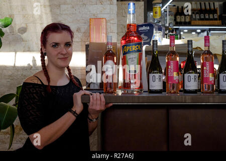 young female barmaid taking a break from work in the dallas bar lenti zala county hungary - Stock Image