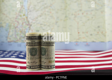 United States currency on American flag with symbolic map image as background reflects connected national and global nature of finance. - Stock Image