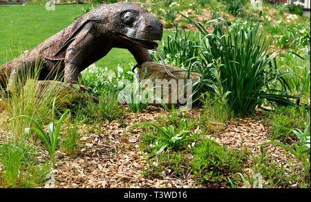 Sculpture of lizard in garden of apartment building The Crescent, Millennium Promenade, Bristol  UK - Stock Image