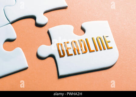 The Word Deadline In Missing Piece Jigsaw Puzzle - Stock Image