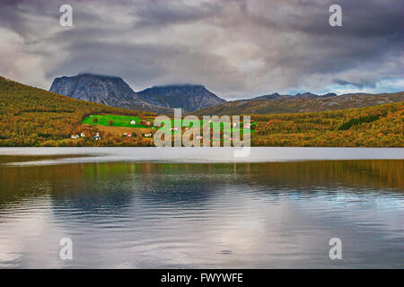 Lake on island Senja in northern Norway on a cloudy day in autumn. - Stock Image
