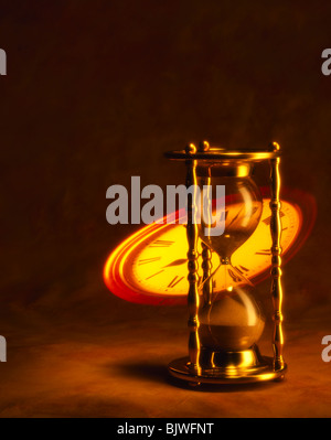 Hour glass with Projected Clock Face - Stock Image