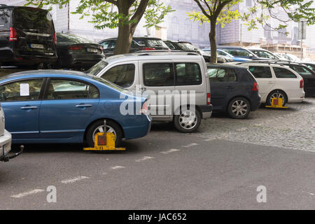 Visitors driving to Prague need to be careful to park correctly. Clamped cars near the National Museum - Stock Image