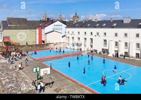 Playground of  the Centro Privado Plurilingüe Padres Franciscanos, the Franciscan Private Multilingual School, seen from the Roman walls, Lugo, Lugo P - Stock Image