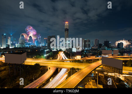 Night view 2018 new year celebration with skyscraper in business district in Bangkok Thailand. Light show at Magnolias Ratchaprasong in Bangkok, Thail - Stock Image