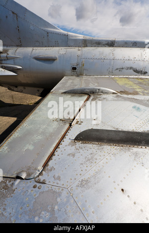 Abandoned aircraft, MiG 21 wing uppersurface and flaps - Stock Image