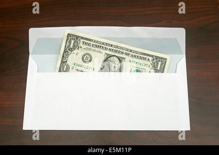 envelope with one dollar - Stock Image