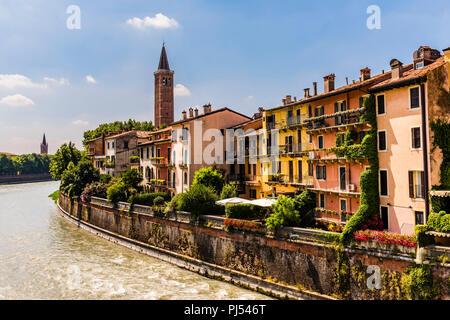 Santa Anastasia tower from Ponte Pietra in Verona, Italy - Stock Image