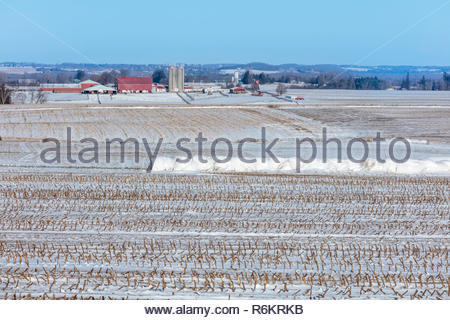 Farm fields covered with the first snow of winter on the Oak Ridges Moraine near Port Perry in Ontario Canada - Stock Image