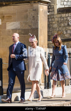 Windsor, UK. 21st April 2019. Mike and Zara Tindall and Princess Beatrice arrive to attend the Easter Sunday Mattins service at St George's Chapel in Windsor Castle. Credit: Mark Kerrison/Alamy Live News - Stock Image