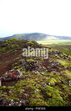 an Icelandic landscape with distant mist covered mountain - Stock Image