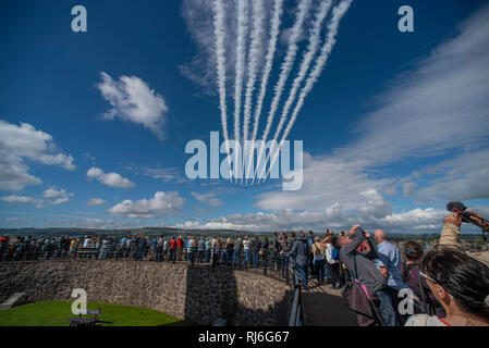 RAF Red Arrows flypast of Clitheroe Castle, Lancashire, UK. - Stock Image
