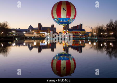 Disney village and its hot air balloon at dusk Marne La Vallee France - Stock Image