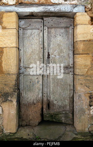 An old medieval door in Chateau de Montfort - a castle in the French commune of Vitrac in the Dordogne region of France - Stock Image