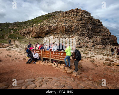 Tourists at the Cape of Good Hope, the south-western point of the African continent, within Cape Point National Park and showing Dias Beach, Western C - Stock Image